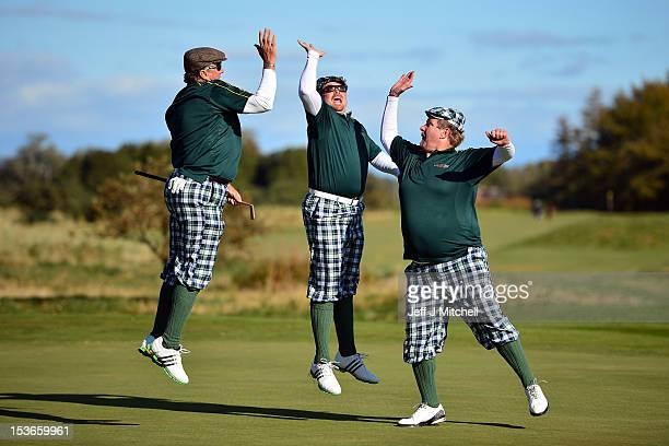 Golfers dressed in 1930s period costume plays on Monifeith Links course during the 8th World Hickory Open on October 8 2012 in Monifeith Scotland The...