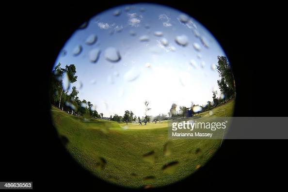Golfers from the group of Lucas Glover Jonathan Byrd and Scott Verplank putt on the first green during Round Two of the Zurich Classic of New Orleans...