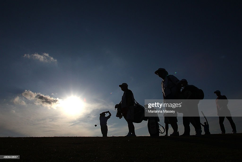 Golfers from the group Woody Austin, Johnson Wagner and Harrison Frazar tee off on the 11th during Round One of the Valero Texas Open at the AT&T Oaks Course on March 27, 2014 in San Antonio, Texas.