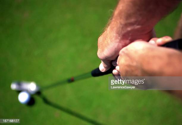 golfer's hands on the club handle