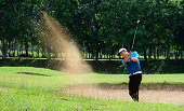 Golfers hit the ball in the sand. Speed and Strength