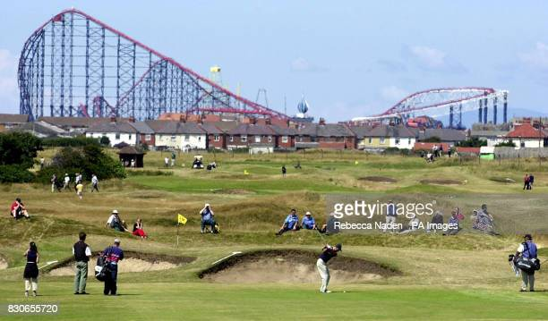 Golfers in action against the backdrop of Blackpool Pleasure Beach during the second round of the 130th Open Championship at the Royal Lytham and St...