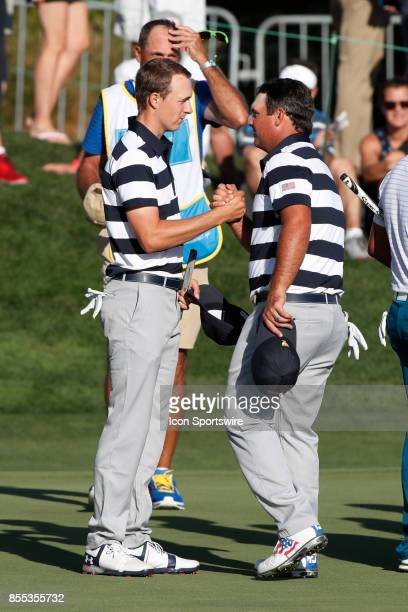 USA golfers Jordan Spieth and Patrick Reed shake hands after winning their match on the 14th hole during the first round of the Presidents Cup on...