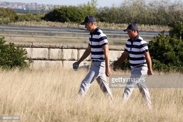 USA golfers Jordan Spieth and Patrick Reed walk the 14th hole during the first round of the Presidents Cup on September 28 at Liberty National Golf...