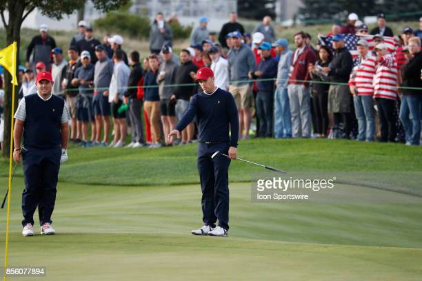USA golfers Jordan Spieth and Patrick Reed walk the 3rd hole during the third round of the Presidents Cup at Liberty National Golf Club on September...