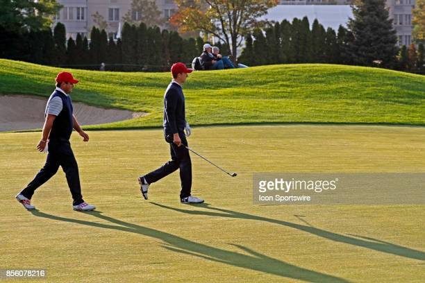 USA golfers Jordan Spieth and Patrick Reed walk the 4th hole during the third round of the Presidents Cup at Liberty National Golf Club on September...