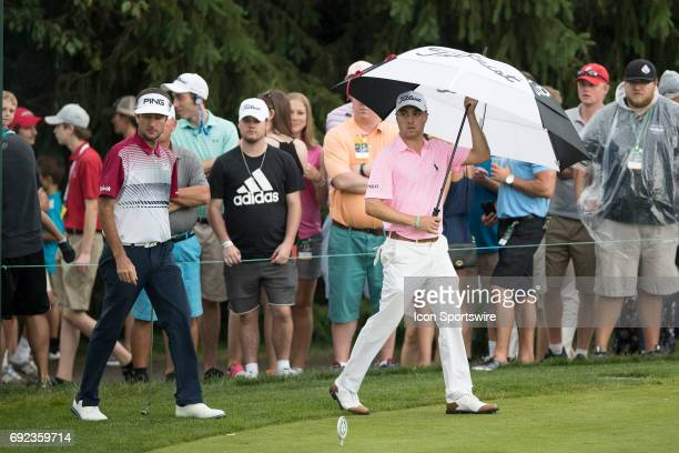 PGA golfers Justin Thomas and Bubba Watson enter the tee box of the 15th hole in the rain during the Memorial Tournament Final Round on June 4 2017...