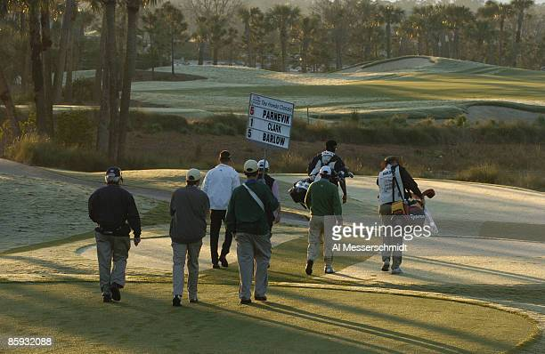 Golfers leave the first tee in earlymorning light in second round competition at the 2005 Honda Classic March 11 2005 in Palm Beach Gardens Florida