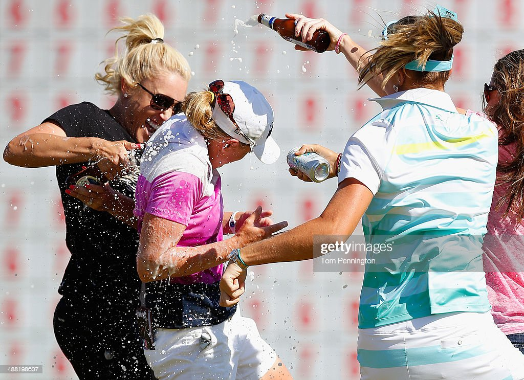 LPGA golfers <a gi-track='captionPersonalityLinkClicked' href=/galleries/search?phrase=Natalie+Gulbis&family=editorial&specificpeople=179451 ng-click='$event.stopPropagation()'>Natalie Gulbis</a>, Lexi Thompson and <a gi-track='captionPersonalityLinkClicked' href=/galleries/search?phrase=Alison+Walshe&family=editorial&specificpeople=5094839 ng-click='$event.stopPropagation()'>Alison Walshe</a> celebrate with <a gi-track='captionPersonalityLinkClicked' href=/galleries/search?phrase=Stacy+Lewis+-+Golfer&family=editorial&specificpeople=4217318 ng-click='$event.stopPropagation()'>Stacy Lewis</a> after Lewis won the North Texas LPGA Shootout Presented by JTBC at the Las Colinas Country Club on May 4, 2014 in Irving, Texas.