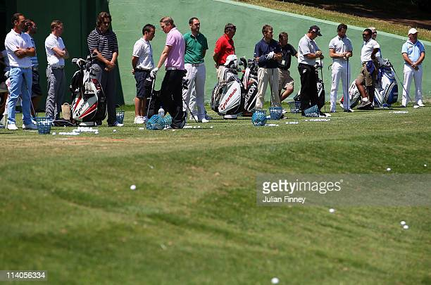 Golfers observe a minutes silence on the driving range to tribute spanish golfing legend Seve Ballesteros on the day of his funeral during the ProAm...