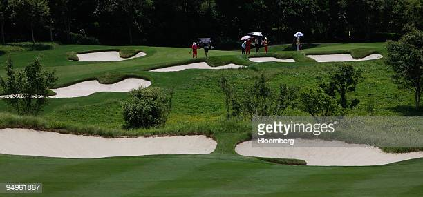 Golfers play a round on the Greg Norman course at the Mission Hills Golf Club in Dongguan China on Wednesday July 1 2009 Norman the former topranked...