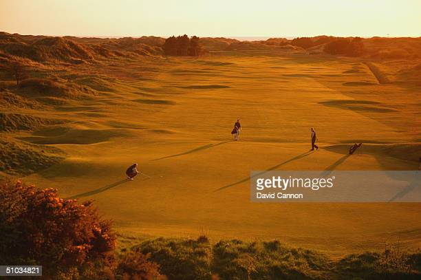 Golfers putt on the 13th green in the late evening light at Royal Birkdale Golf Club on April 21 2004 in Birkdale England