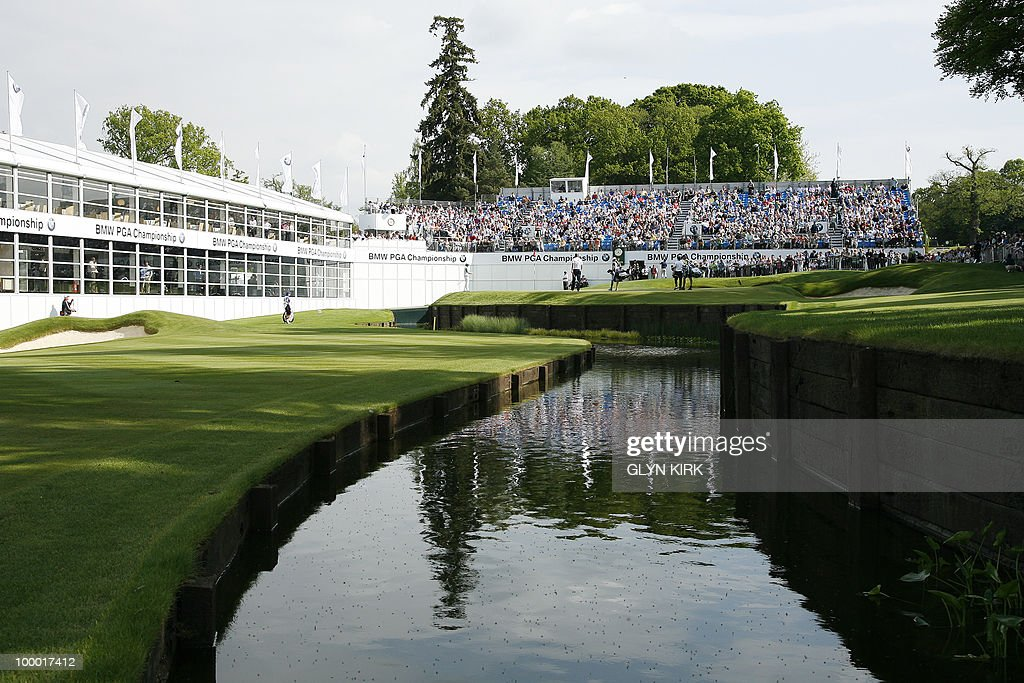 Golfers putt on the 18th green during the first day of the PGA Championship on the West Course at Wentworth, England, on May 20, 2010.