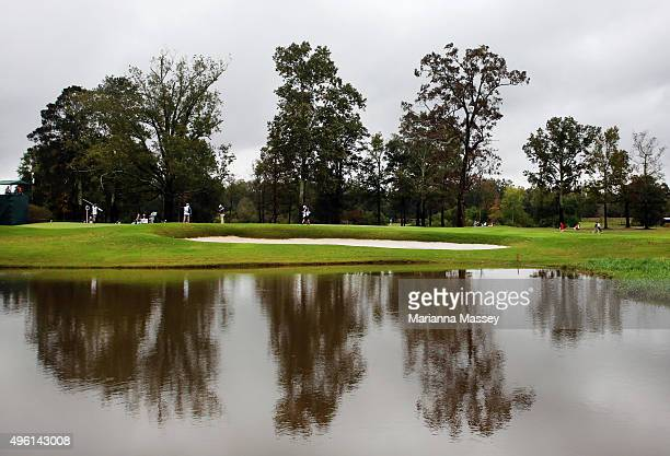 Golfers putt on the first green during a continuation of the second round of the Sanderson Farms Championship at The Country Club of Jackson on...