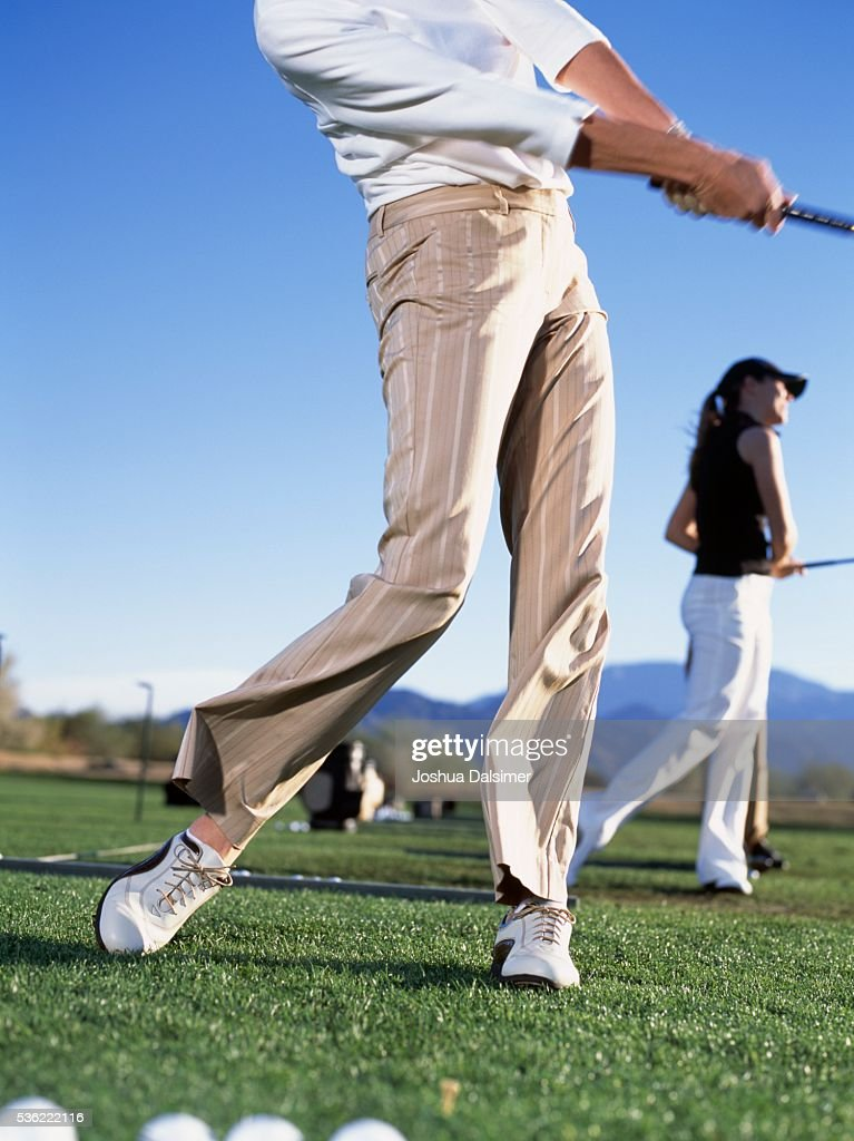Golfers teeing off : Stock Photo