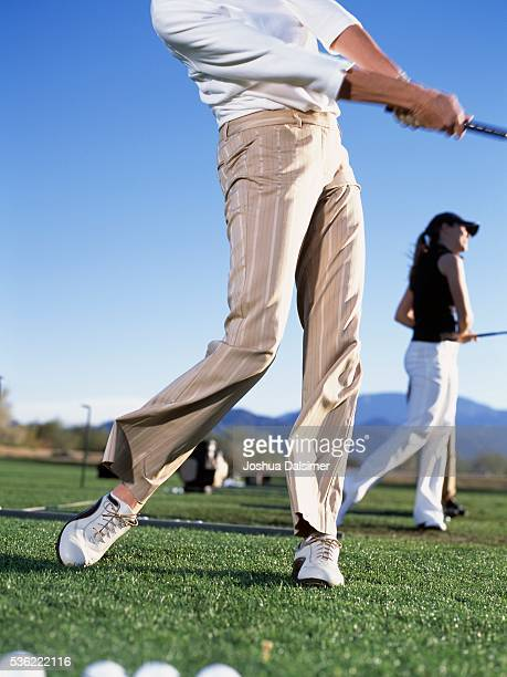 Golfers teeing off