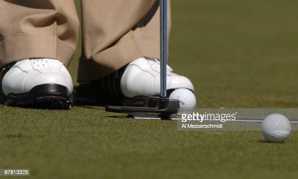 Golfers use allignment devices on the practice putting green at the 2006 Honda Classic March 7 at the Country Club at Mirasol in Palm Beach Gardens...