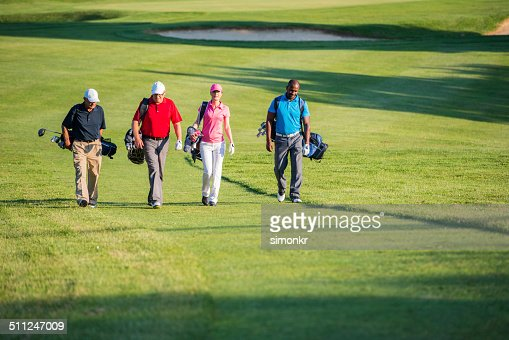 Golfers Walking On The Golf Course