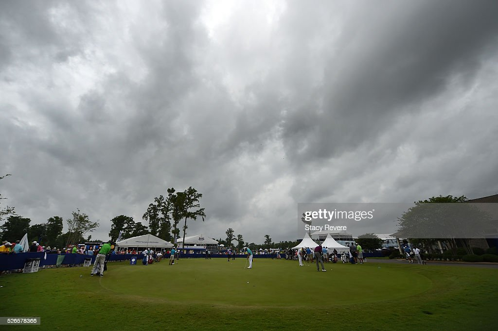 Golfers warm up on the practice range prior to the start of play as weather approaches during the third round of the Zurich Classic at TPC Louisiana on April 30, 2016 in Avondale, Louisiana.