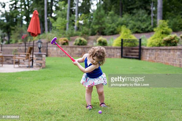 Golfing in backyard