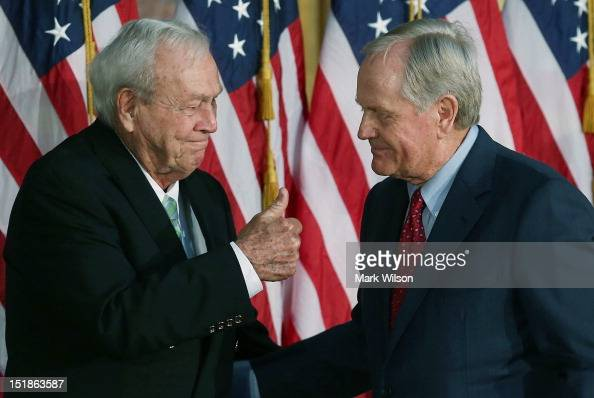 Golfing legend Arnold Palmer gives Jack Nicklaus a thumbs up during a Congressional Gold Medal ceremony at the US Capitol on September 12 2012 in...