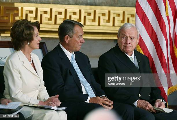 Golfing legend Arnold Palmer sits with Speaker of the House John Boehner and House Minority Leader Nancy Pelosi before recieving the Congressional...