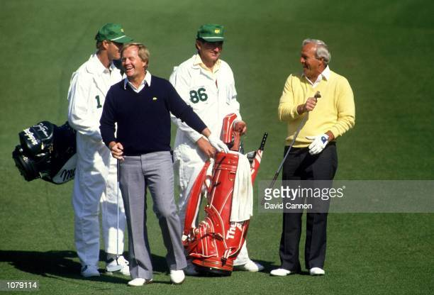 Golfing legends Jack Nicklaus and Arnold Palmer of the USA share a joke during the US Masters on April 9 1987 at Augusta National Golf Club in...