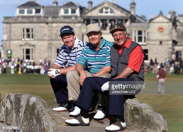 Golfing legends Tom Watson of USA Jack Nicklaus of USA and Roberto de Vicenzo of Argentina pose on the bridge over the Swilken Burn in front of the...