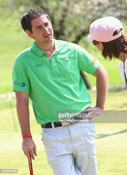 Golfpro Fabian Becker gives instructions to soccer player Bianca Rech during the Puma meets Media Golf Event at the Golf Club Erlangen on May 8 2008...