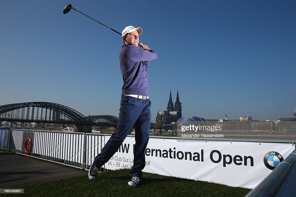 Golfsport Ambassador <a gi-track='captionPersonalityLinkClicked' href=/galleries/search?phrase=Maximilian+Kieffer&family=editorial&specificpeople=3333431 ng-click='$event.stopPropagation()'>Maximilian Kieffer</a> hits the symbolic Tee-Off shot over the fully-electric BMW i3 on board the 'Pure-Liner' event ship as it makes its way from Cologne to Duesseldorf on the Rhine river hosting a press conference for the 2014 BMW International Open on March 25, 2014 in Cologne, Germany. The BMW International Open is the only European Tour tournament on German soil and will be held from 24th to 29th June 2014 at Colognes Golf Club Gut Laerchenhof.