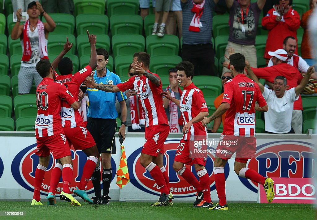 Golgol Mebrahtu of the Heart celebrates his goal with team mates during the round 10 A-League match between the Melbourne Heart and the Perth Glory at AAMI Park on December 8, 2012 in Melbourne, Australia.