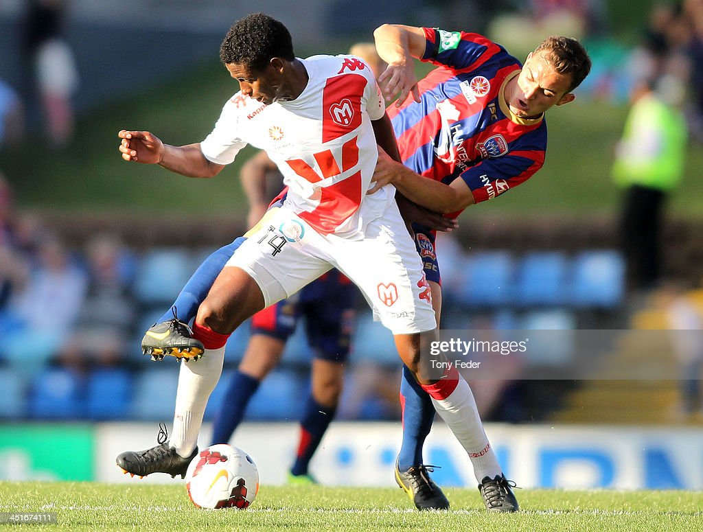 Golgol Mebrahtu of the Heart contests the ball with his Jets opponent during the round seven A-League match between the Newcastle Jets and the Melbourne Heart at Hunter Stadium on November 24, 2013 in Newcastle, Australia.