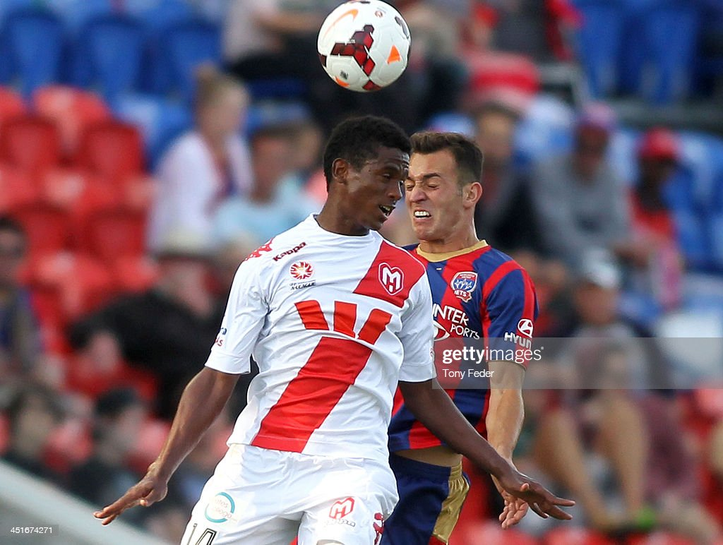 Golgol Mebrahtu of the Heart heads the ball during the round seven A-League match between the Newcastle Jets and the Melbourne Heart at Hunter Stadium on November 24, 2013 in Newcastle, Australia.