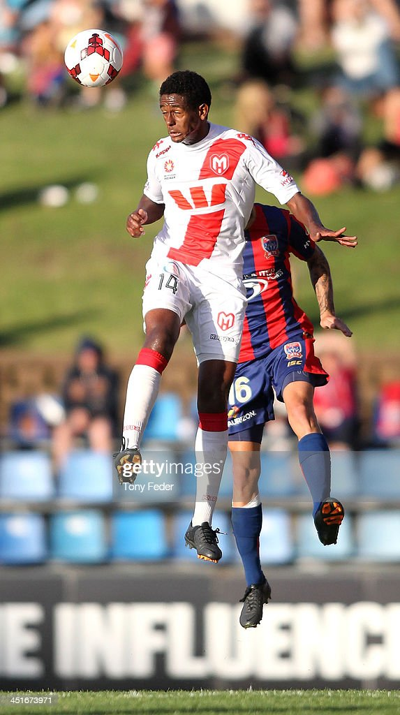 Golgol Mebrahtu of the Heart heads the ball in front of Jacob Pepper of the Jets during the round seven A-League match between the Newcastle Jets and the Melbourne Heart at Hunter Stadium on November 24, 2013 in Newcastle, Australia.