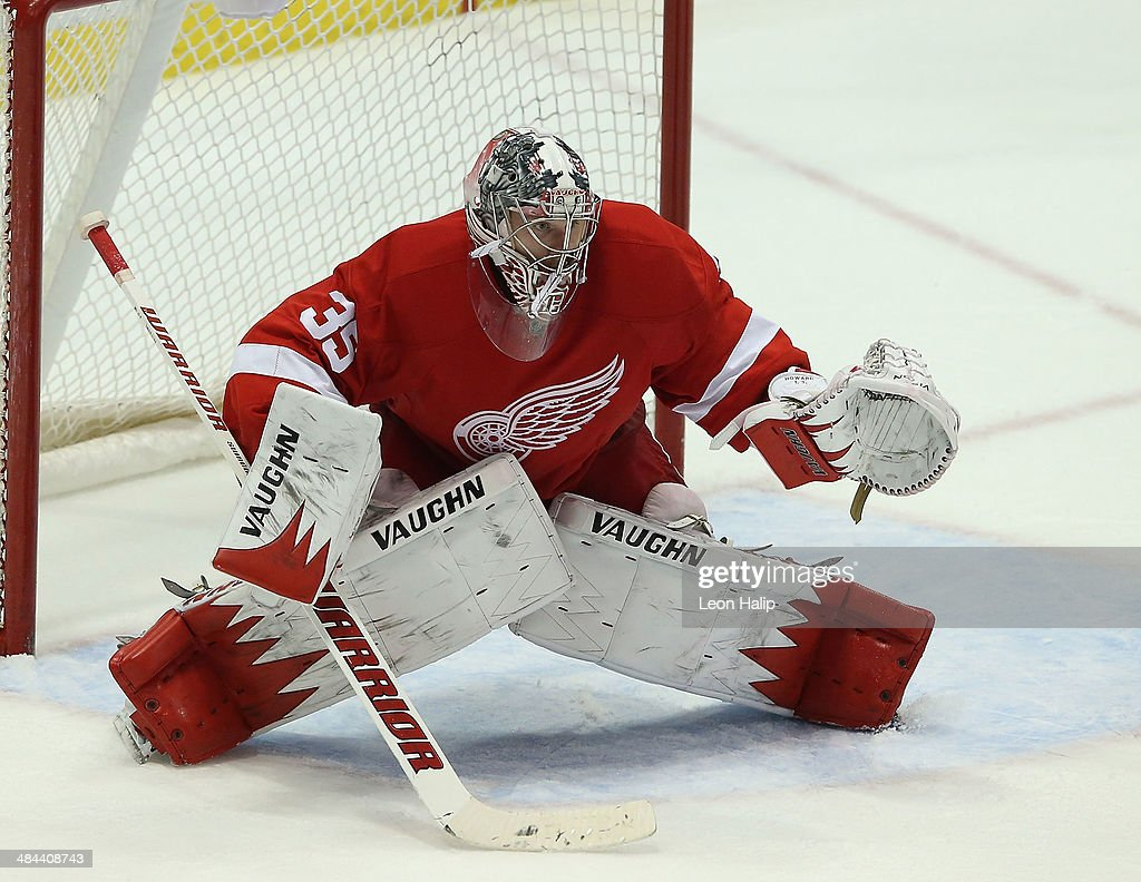 Golie Jimmy Howard #35 of the Detroit Red Wings looks to make the stop during the third period of the game against the Boston Bruins at Joe Louis Arena on April 2, 2014 in Detroit, Michigan. The Wings defeated the Bruins 3-2.