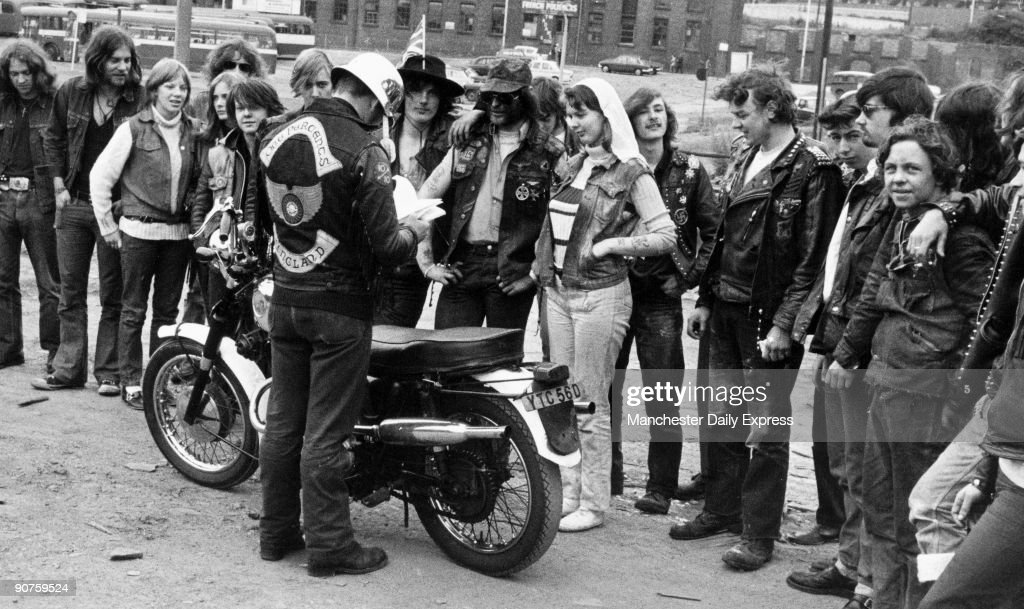 Golly and Sugar are married by Scouse (in steel helmet), attended by their biker friends.