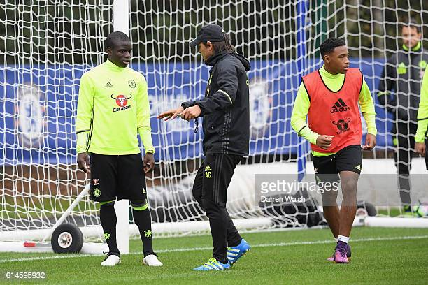 Golo Kante and Antonio Conte of Chelsea during a training session at Chelsea Training Ground on October 14 2016 in Cobham England