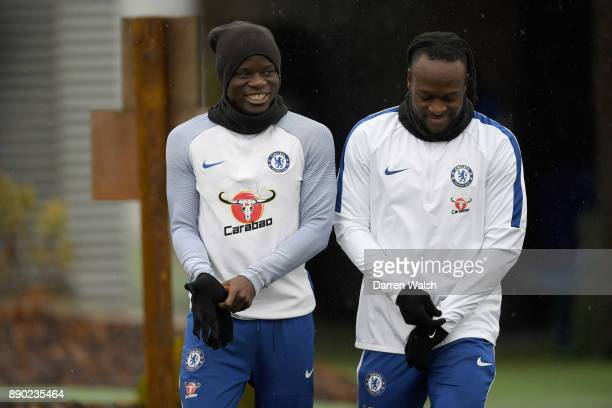Golo Kante and Victor Moses of Chelsea during a training session at Chelsea Training Ground on December 11 2017 in Cobham England