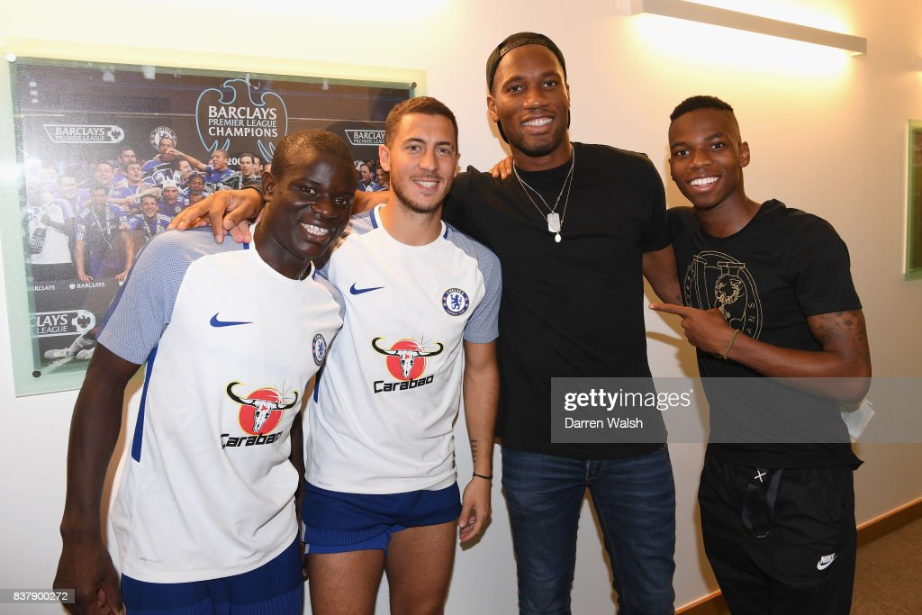 N'Golo Kante, Eden Hazard and Charly Musonda of Chelsea with Ex Chelsea player Didier Drogba after a training session at Chelsea Training Ground on August 23, 2017 in Cobham, England.