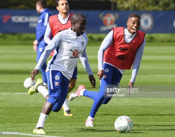 N'Golo Kante is pursued by Charly Musonda of Chelsea during a training session at Chelsea Training Ground on September 19 2017 in Cobham England