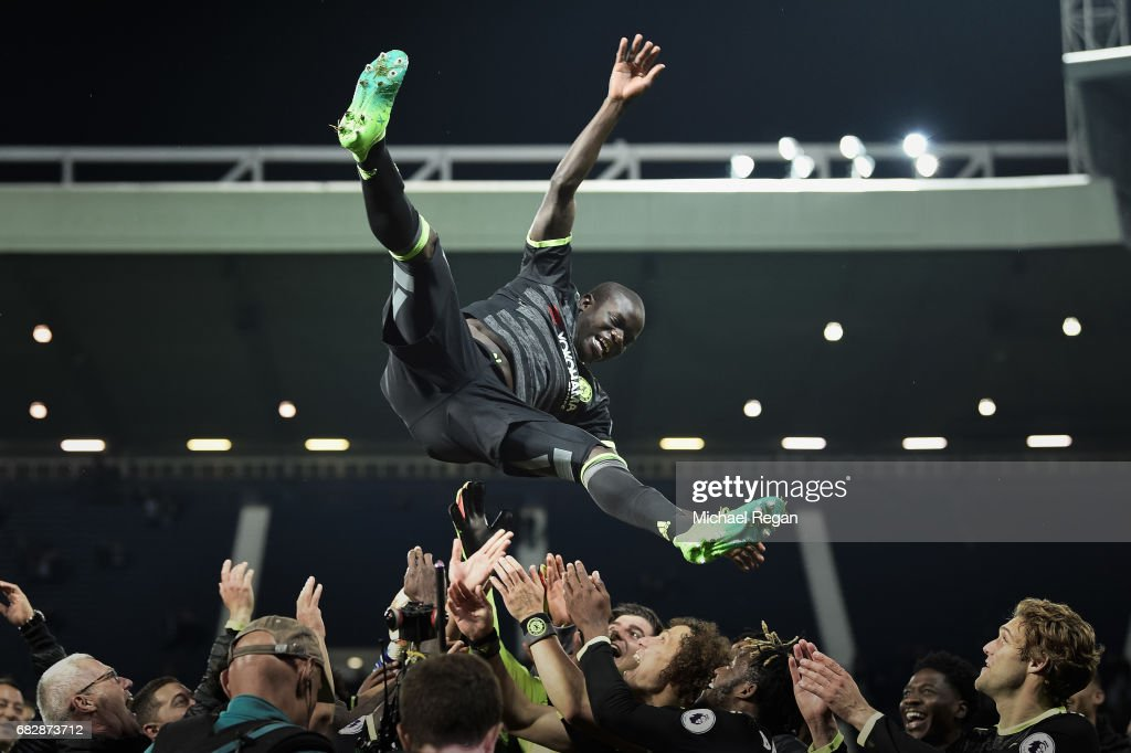 N'Golo Kante is thrown in the air by team mates as Chelsea celebrate winning the league after the Premier League match between West Bromwich Albion and Chelsea at The Hawthorns on May 12, 2017 in West Bromwich, England. Chelsea are crowned champions after a 1-0 victory against West Bromwich Albion. Restrictions