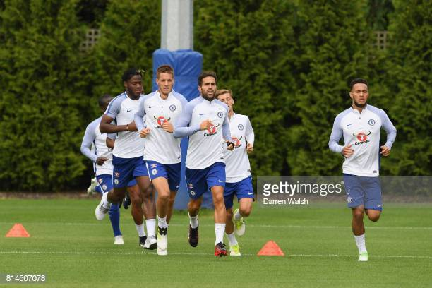 Golo Kante Michy Batshuayi Mario Pasalic Cesc Fabregas Kyle Scott and Lewis Baker of Chelsea during a training session at Chelsea Training Ground on...
