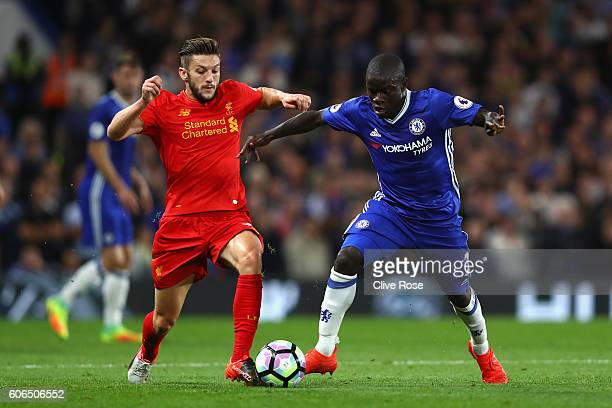 Golo Kante of Chelsea and Adam Lallana of Liverpool battle for possession during the Premier League match between Chelsea and Liverpool at Stamford...