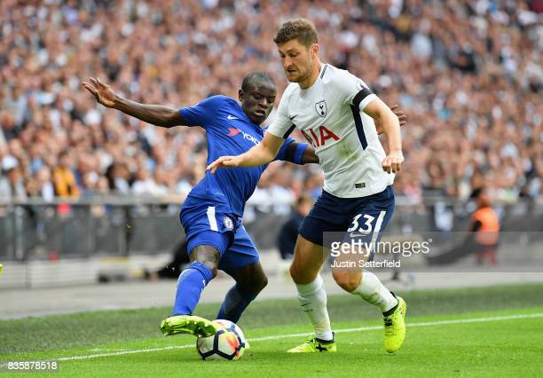 Golo Kante of Chelsea and Ben Davies of Tottenham Hotspur battle for possession during the Premier League match between Tottenham Hotspur and Chelsea...
