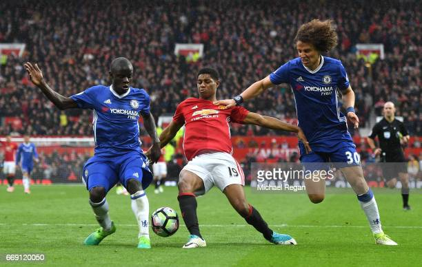 Golo Kante of Chelsea and David Luiz of Chelsea attempt to tackle Marcus Rashford of Manchester United during the Premier League match between...