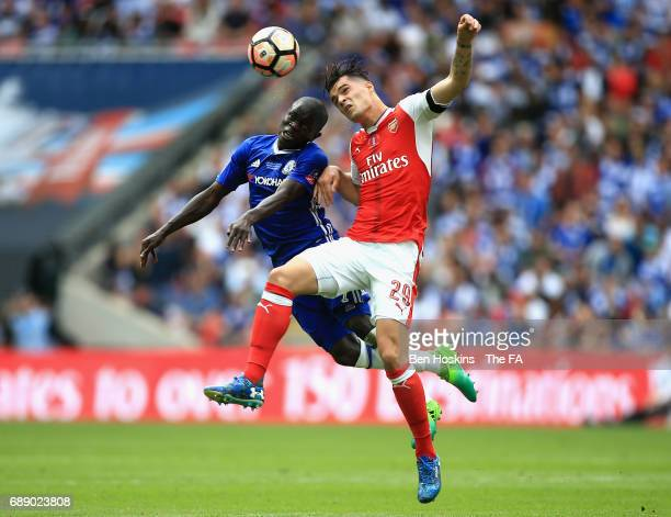 Golo Kante of Chelsea and Granit Xhaka of Arsenal challenge for the ball during The Emirates FA Cup Final between Arsenal and Chelsea at Wembley...