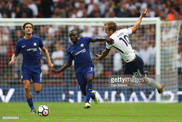 Golo Kante of Chelsea and Harry Kane of Tottenham Hotspur battle for possession during the Premier League match between Tottenham Hotspur and Chelsea...