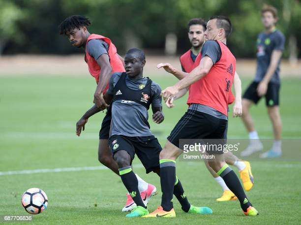 Golo Kante of Chelsea and John Terry of Chelsea battle for possession during a Chelsea training session at Chelsea Training Ground on May 24 2017 in...