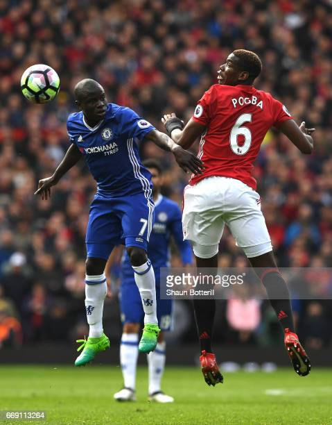 Golo Kante of Chelsea and Paul Pogba of Manchester United battle to win a header during the Premier League match between Manchester United and...