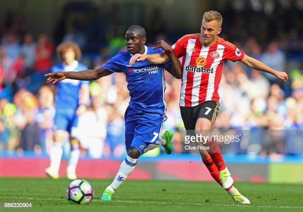 Golo Kante of Chelsea and Sebastian Larsson of Sunderland clash during the Premier League match between Chelsea and Sunderland at Stamford Bridge on...